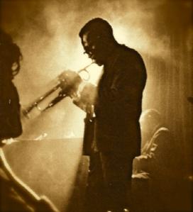 Miles Davis playing trumpet